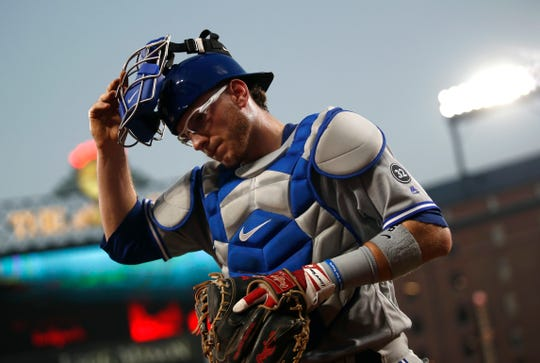 Danny Jansen walks off the field between innings of a game at Oriole Park at Camden Yards in Baltimore.