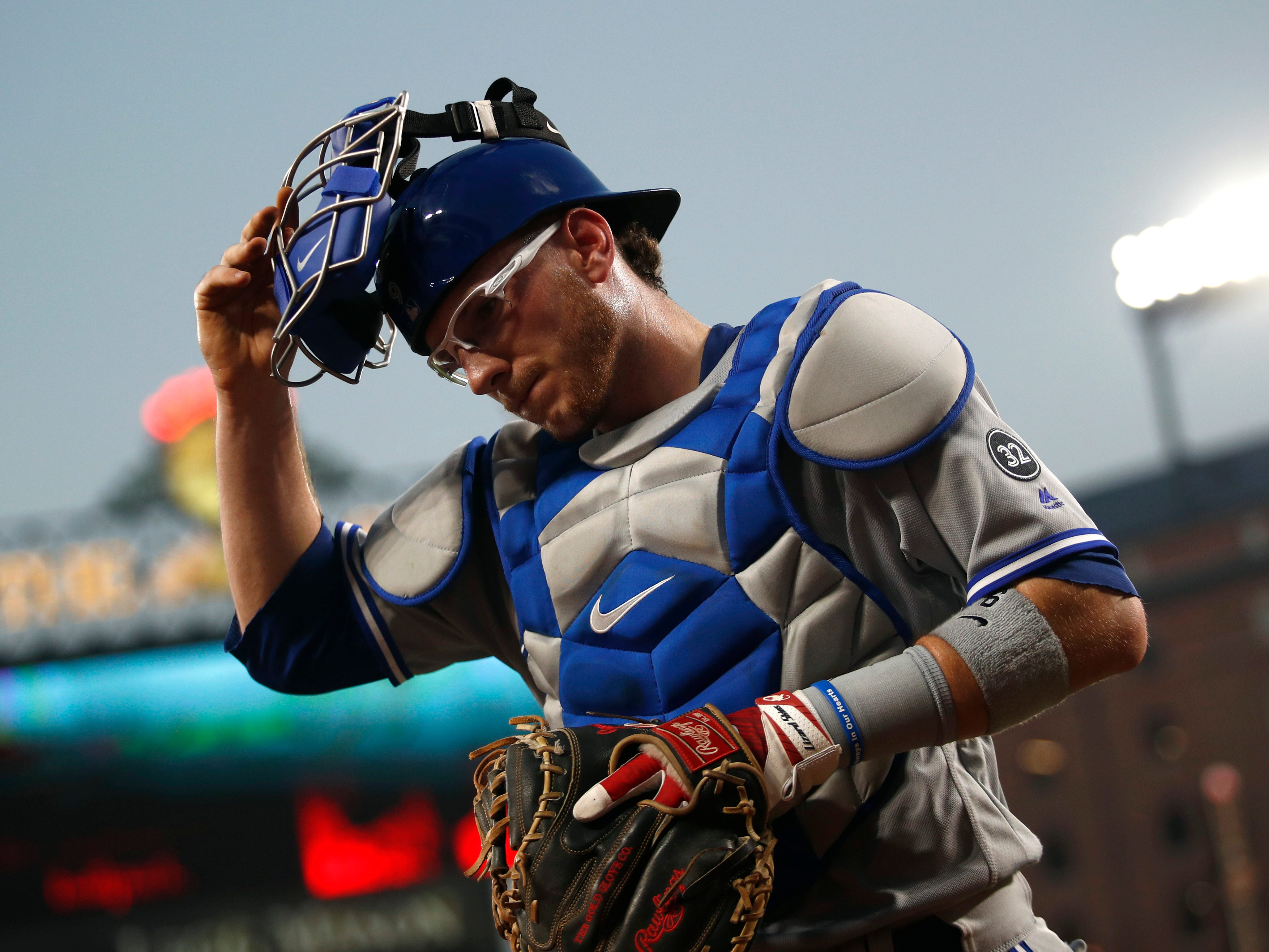 Toronto Blue Jays catcher Danny Jansen walks off the field between innings of a baseball game against the Baltimore Orioles, Tuesday, Aug. 28, 2018, in Baltimore. (AP Photo/Patrick Semansky)
