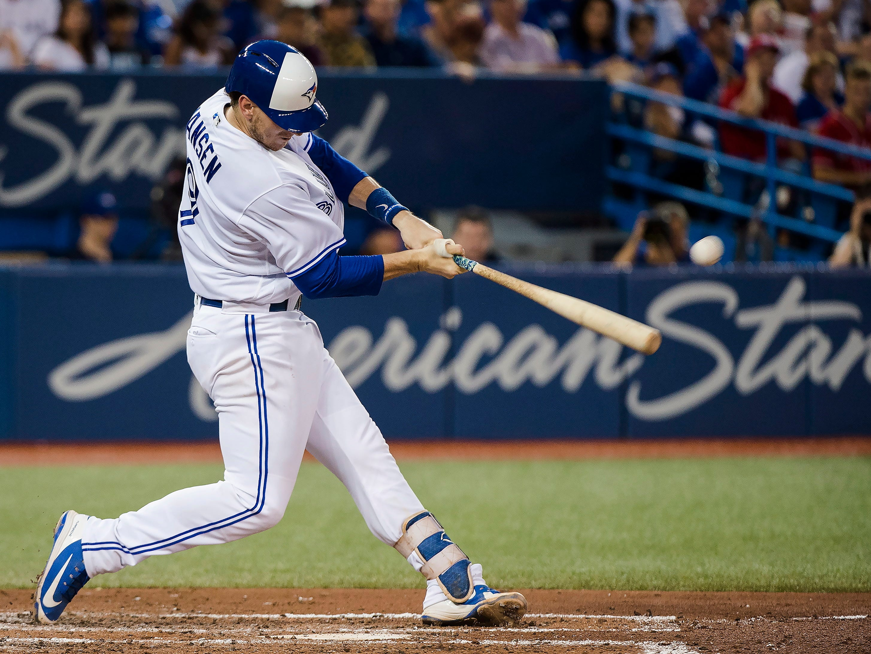 Toronto Blue Jays' Danny Jansen hits a ground-rule double to left field against the Baltimore Orioles during fourth-inning baseball game action in Toronto, Monday, Aug. 20, 2018. (Nathan Denette/The Canadian Press via AP)