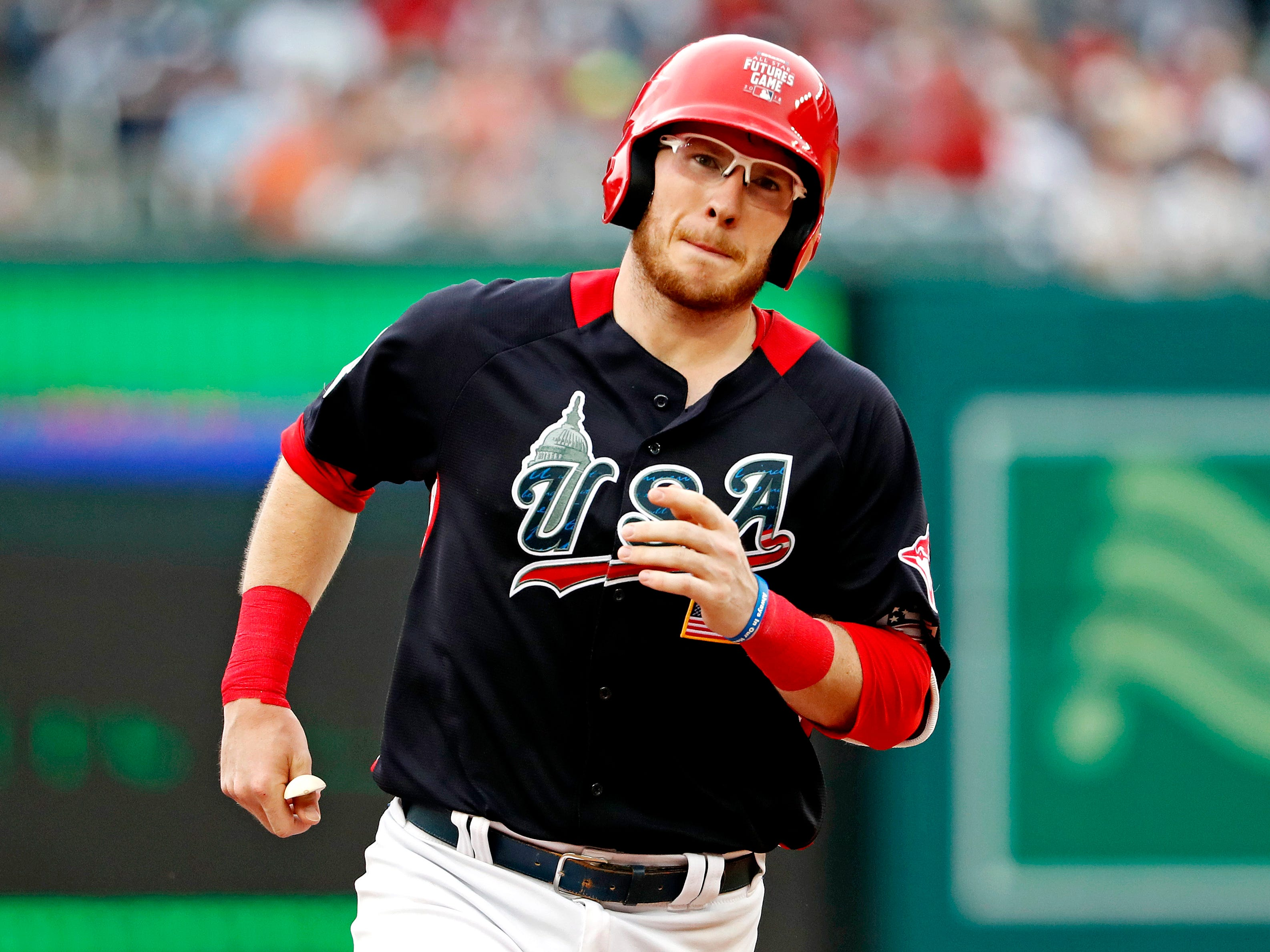 Jul 15, 2018; Washington, DC, USA; USA catcher Danny Jansen (9) rounds the bases after hitting a two run home run in the fourth inning against the World Team during the 2018 All Star Futures Game at Nationals Ballpark. Mandatory Credit: Geoff Burke-USA TODAY Sports