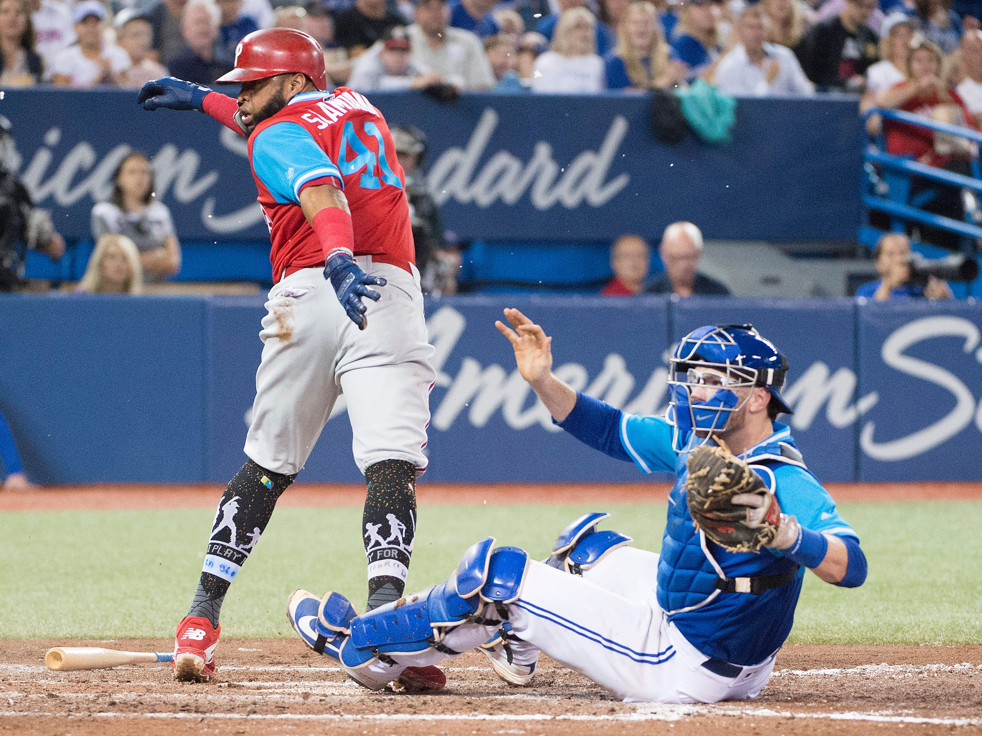 Aug 25, 2018; Toronto, Ontario, CAN; Toronto Blue Jays catcher Danny Jansen (9) tags out Philadelphia Phillies first baseman Carlos Santana (41) at home plate during the fifth inning at Rogers Centre. Mandatory Credit: Nick Turchiaro-USA TODAY Sports