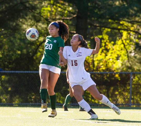 Colts Neck's Ella Cano and Matawan's Jessica Labinger battle for ball near midfield during first half action. Matawan Girls Soccer vs Colts Neck in Marlboro NJ on October 12, 2018