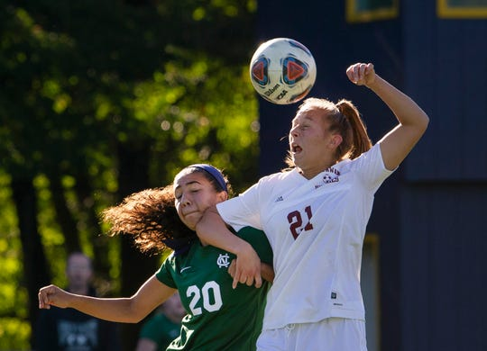 Colts Neck's Ella Cano and Matawan's Bryn Radvinski battle for ball near midfield durng first half action.  Matawan Girls Soccer vs Colts Neck in Marlboro NJ on October 12, 2018