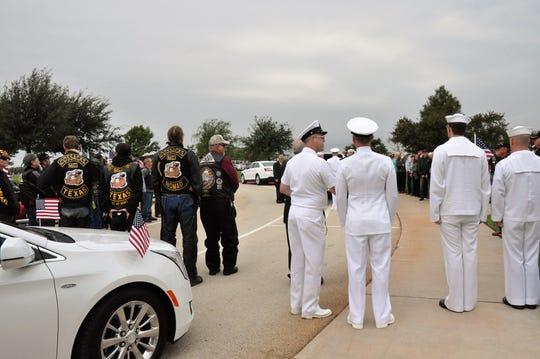 People quietly gathered outside the pavilion at the Texas State Veterans Cemetery before the funeral for Navy Reserve Cmdr. Charles B. Goodwin of Haskell on Friday.