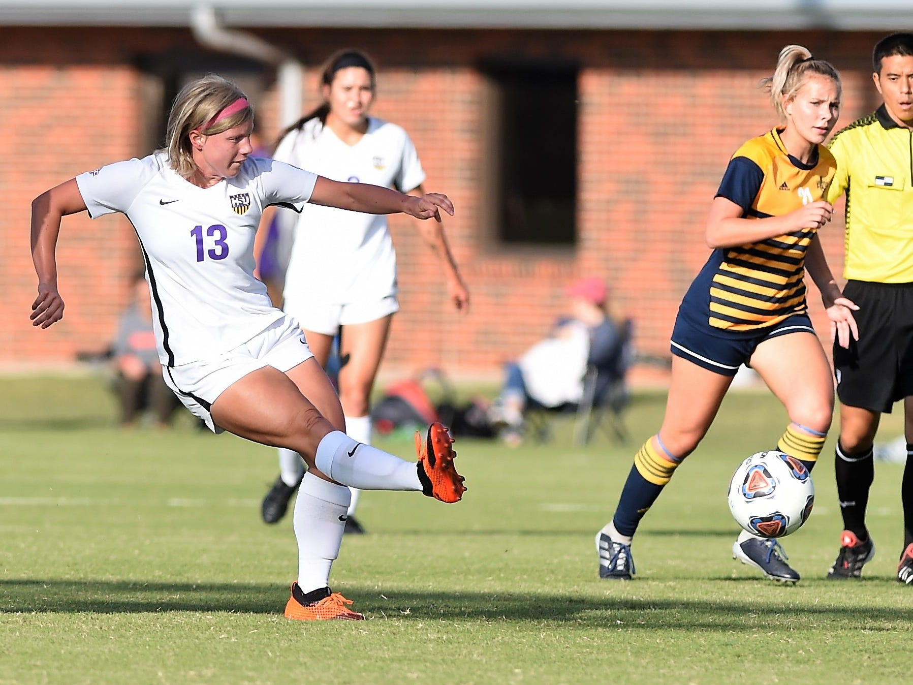Hardin-Simmons midfielder Josey Meyer (13) passes into the box at the HSU Soccer Complex on Thursday, Oct. 11, 2018. The Cowgirls won 4-1.
