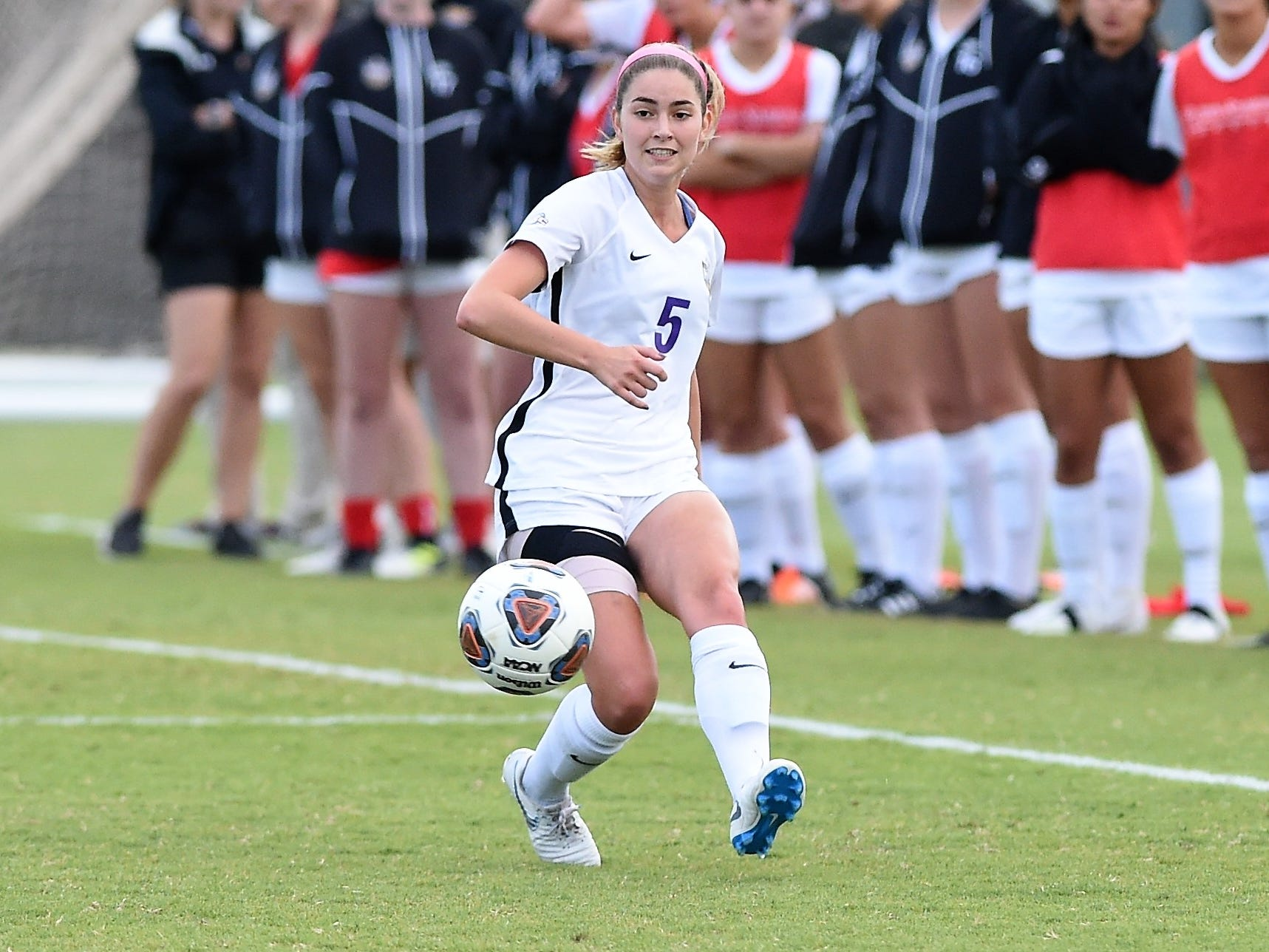 Hardin-Simmons midfielder Evan Pipkin (5) makes a pass against Howard Payne at the HSU Soccer Complex on Thursday, Oct. 11, 2018. The Cowgirls won 4-1.