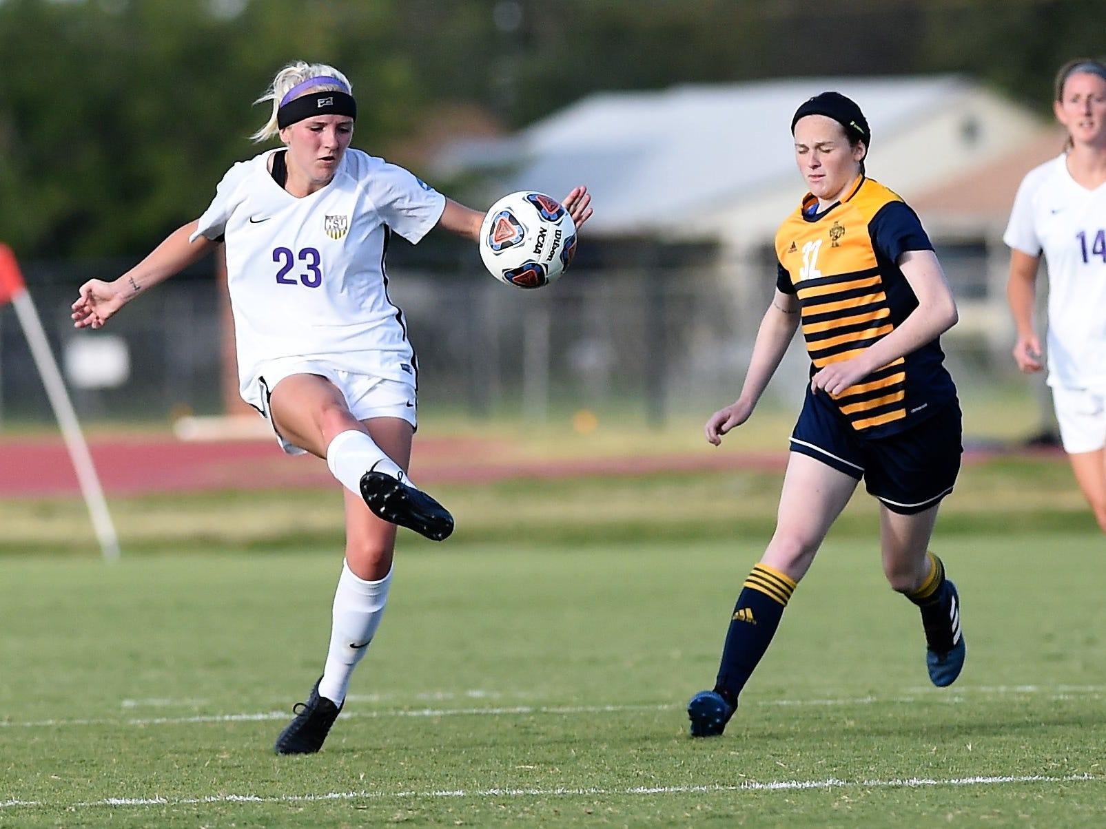 Hardin-Simmons defender Baylee Ford (23) clears the ball against Howard Payne at the HSU Soccer Complex on Thursday, Oct. 11, 2018. The Cowgirls won 4-1.