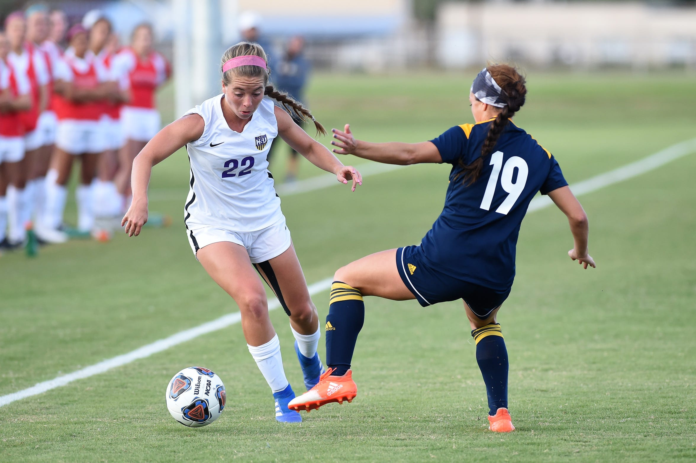 Hardin-Simmons defender Kendell Groom (22) makes a move past a Howard Payne defender earlier this season. Groom was the only returning starter at defense from last year's team. The Cowgirls take an eight-game shutout streak into the NCAA Division III sectionals this weekend in Vermont.