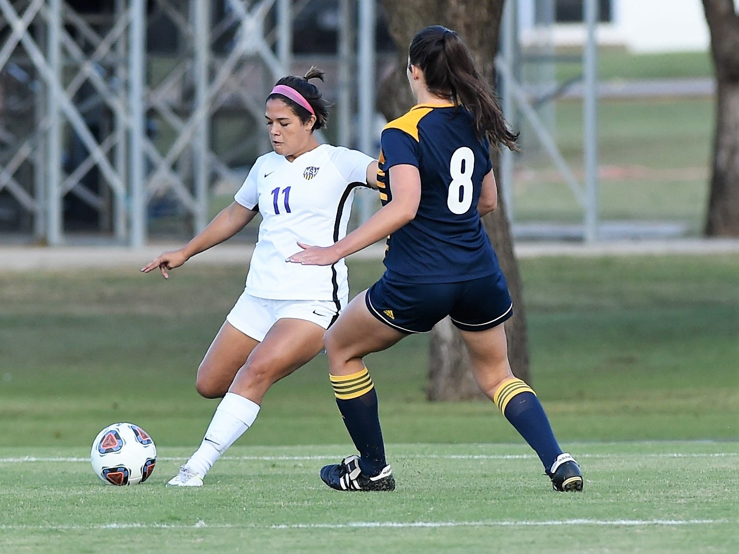 Hardin-Simmons defender Avery Lara (11) crosses the ball against Howard Payne at the HSU Soccer Complex on Thursday, Oct. 11, 2018. The Cowgirls won 4-1.