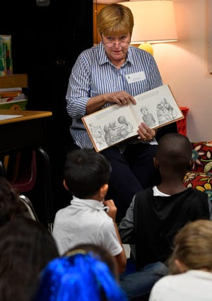 """Cindy Earles, a member of the Abilene Independent School District board, reads to a first grade class at Bowie Elementary School Wednesday. She was one of several local """"celebrities,"""" including Reporter-News education writer Timothy Chipp, who read to students during the Reading Rodeo that day."""