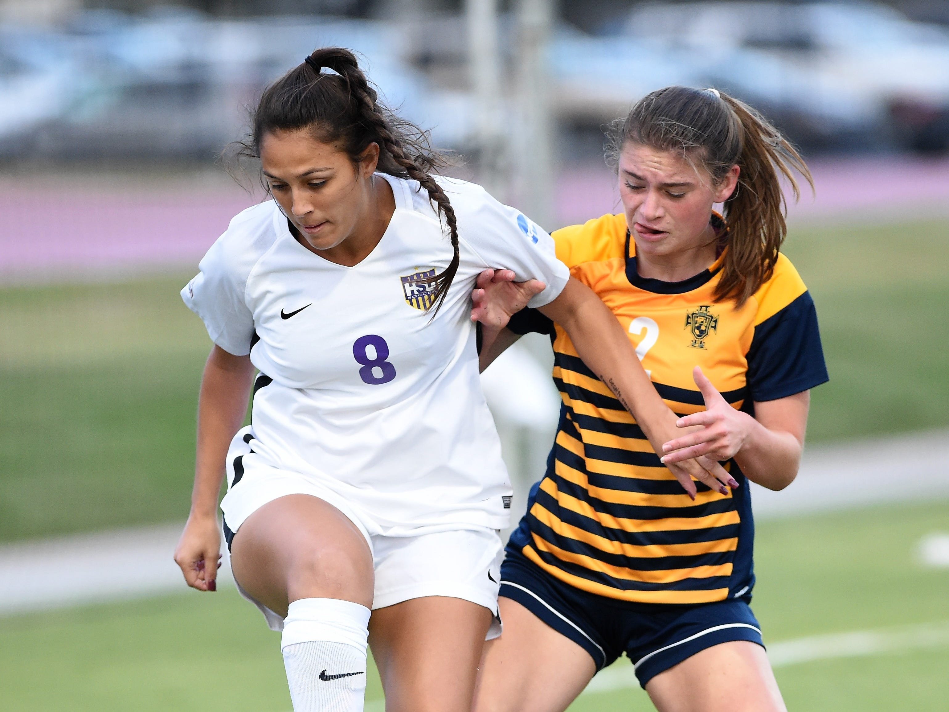 Hardin-Simmons forward Taylor Bernal (8) blocks Howard Payne's Anna Leffers (2) from the ball at the HSU Soccer Complex on Thursday, Oct. 11, 2018. The Cowgirls won 4-1.