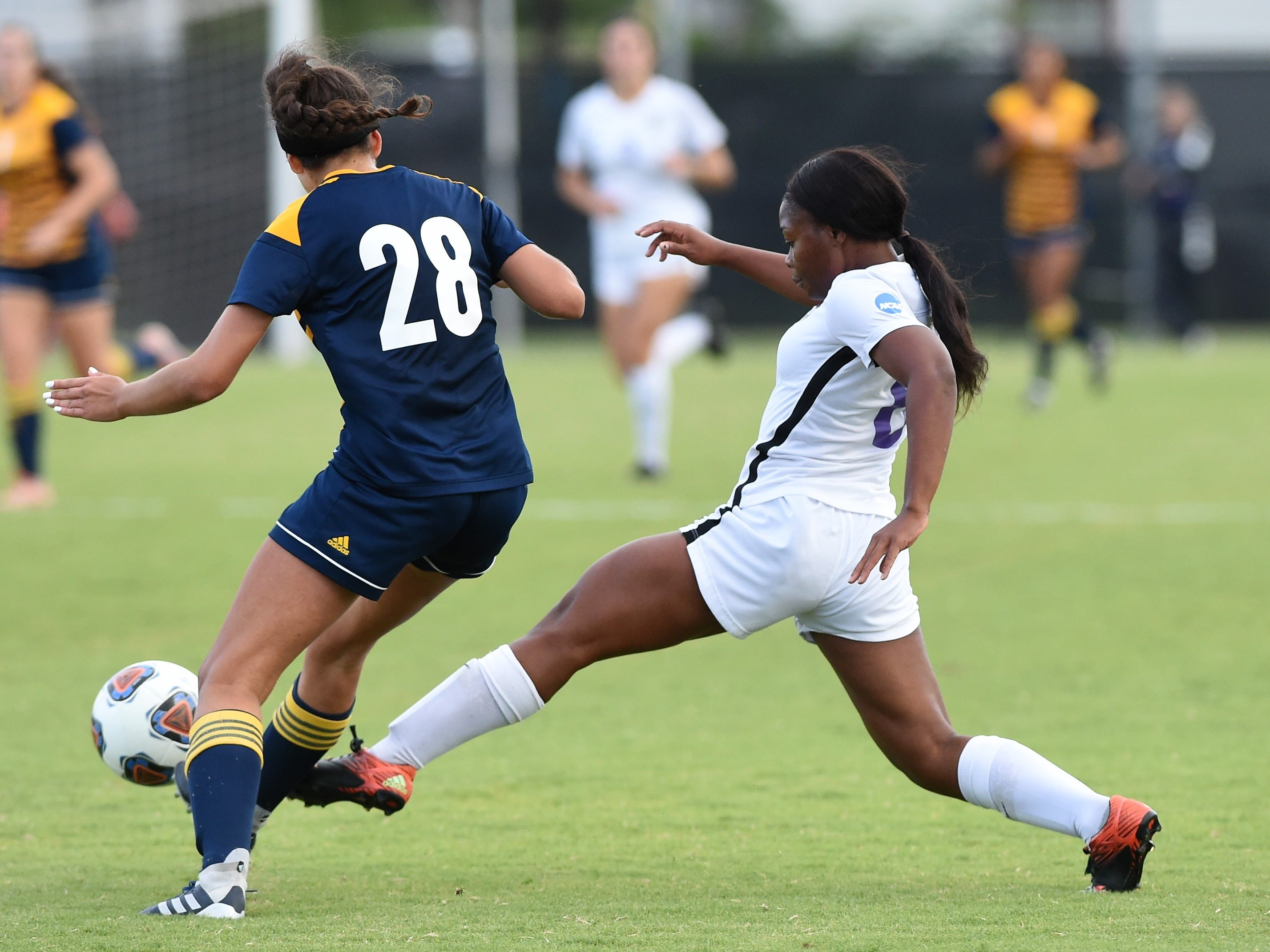 Hardin-Simmons forward Finda Kollie (6) reaches for the ball against Howard Payne's Leah Gordish (28) at the HSU Soccer Complex on Thursday, Oct. 11, 2018. The Cowgirls won 4-1.