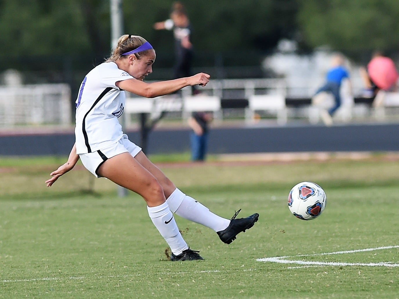 Hardin-Simmons midfielder Mackensie Moreno (30) hits a pass at midfield against Howard Payne at the HSU Soccer Complex on Thursday, Oct. 11, 2018. The Cowgirls won 4-1.
