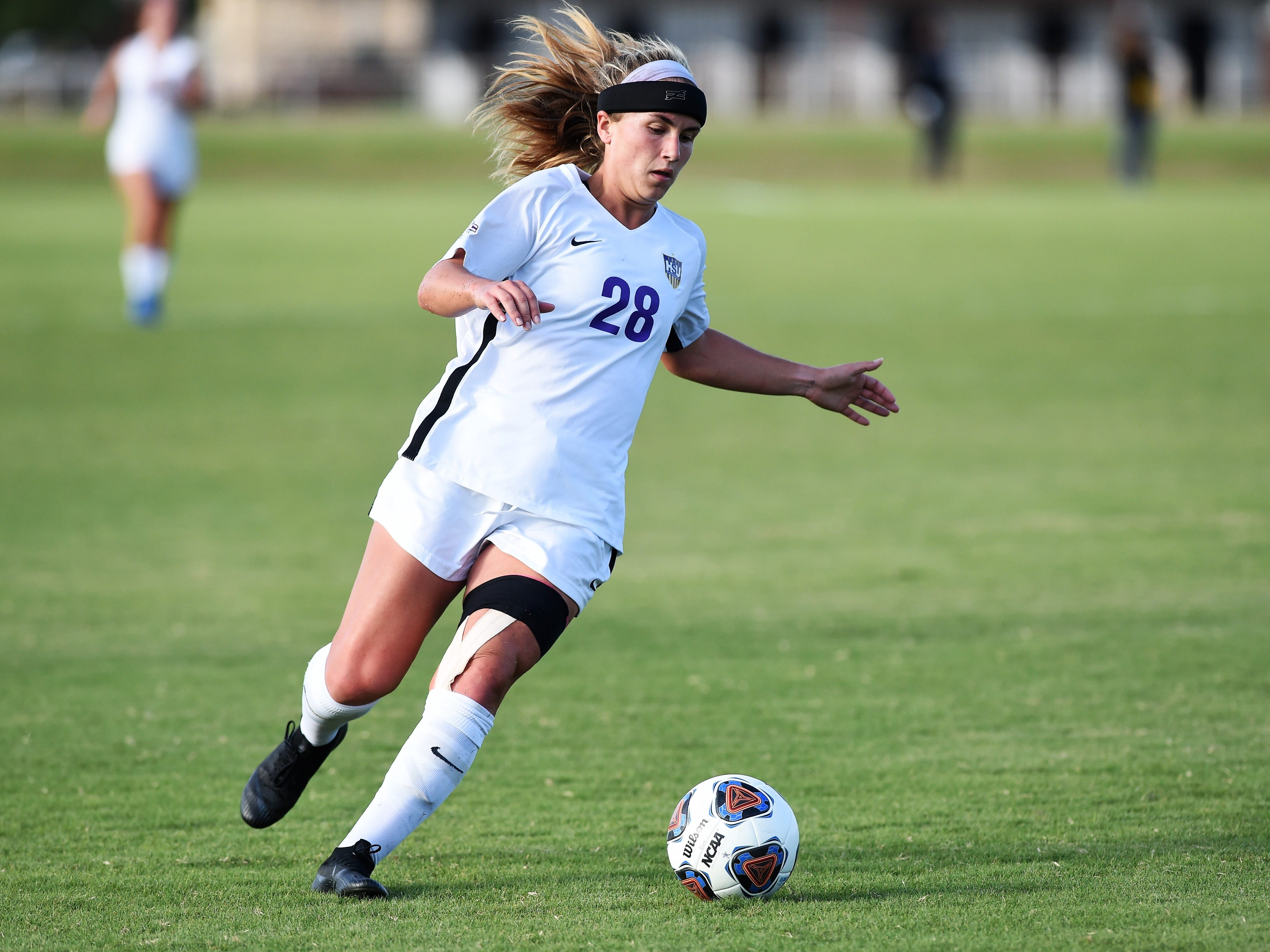 Hardin-Simmons midfielder Kenne Kessler (28) plays the ball against Howard Payne at the HSU Soccer Complex on Thursday, Oct. 11, 2018. The Cowgirls won 4-1.