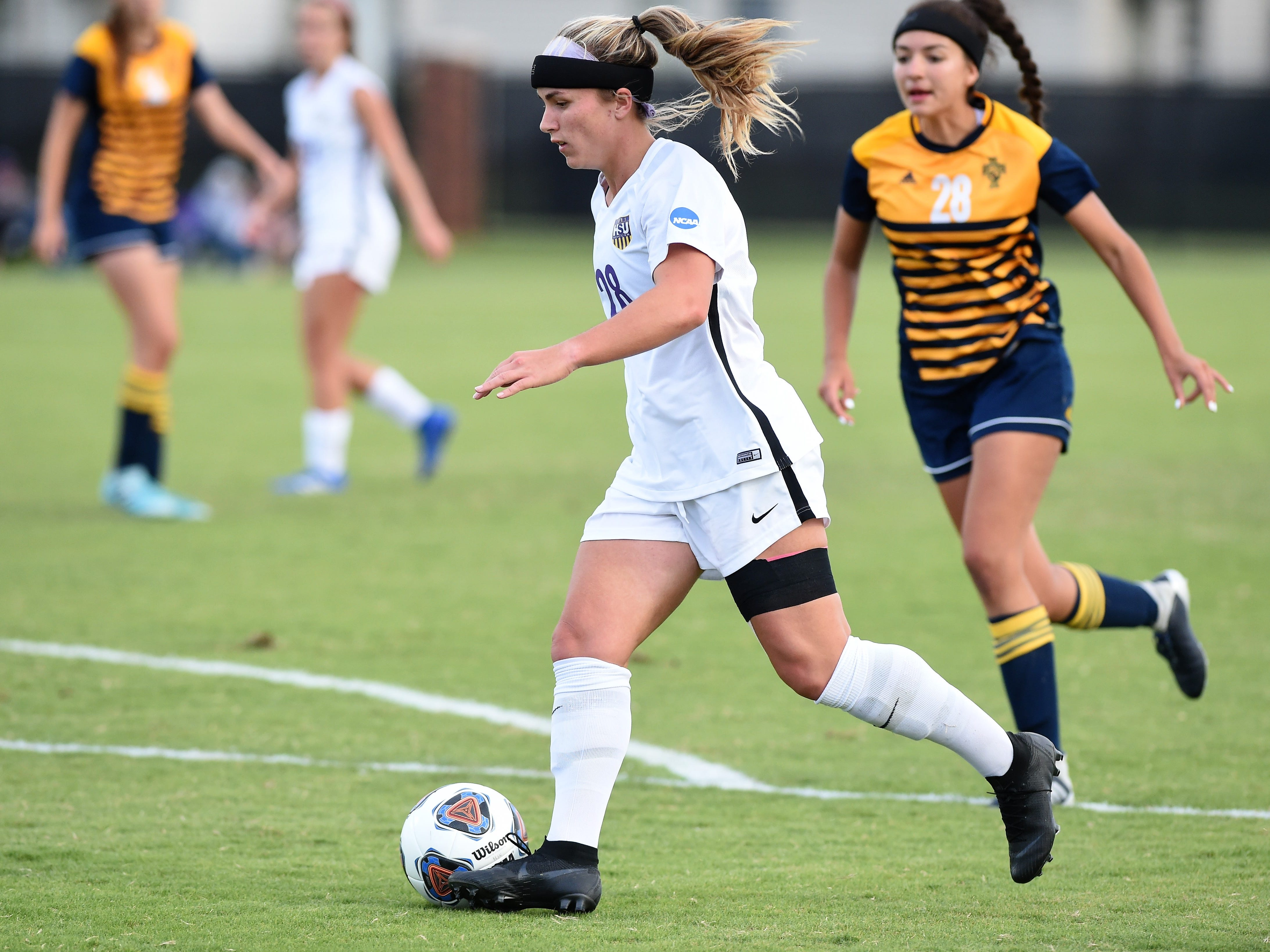 Hardin-Simmons' Kenne Kessler (28) carries the ball into the box aginst Howard Payne at the HSU Soccer Complex on Thursday, Oct. 11, 2018. The Cowgirls won 4-1.