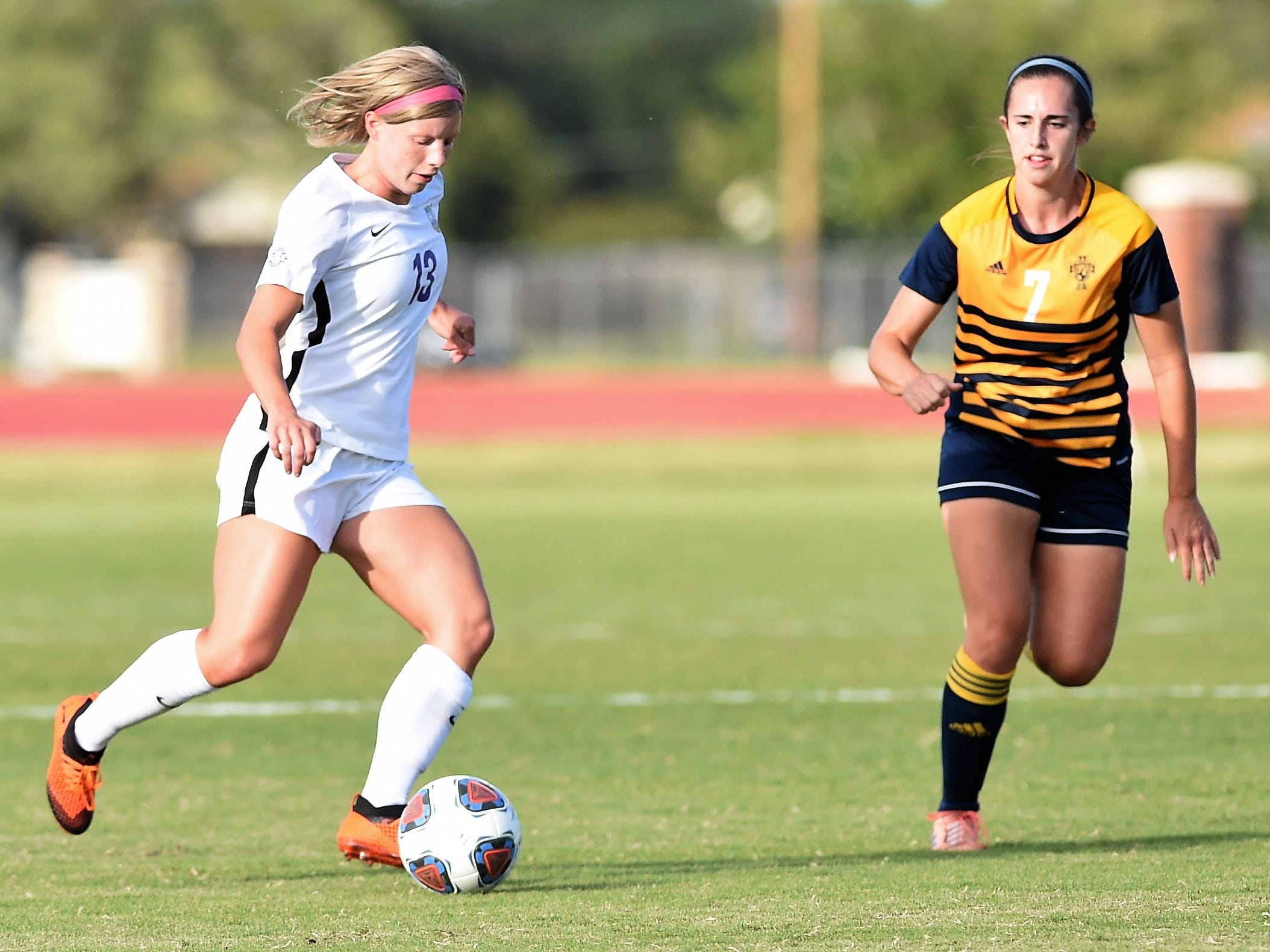 Hardin-Simmons midfielder Josey Meyer (13) plays the ball against Howard Payne at the HSU Soccer Complex on Thursday, Oct. 11, 2018. The Cowgirls won 4-1.