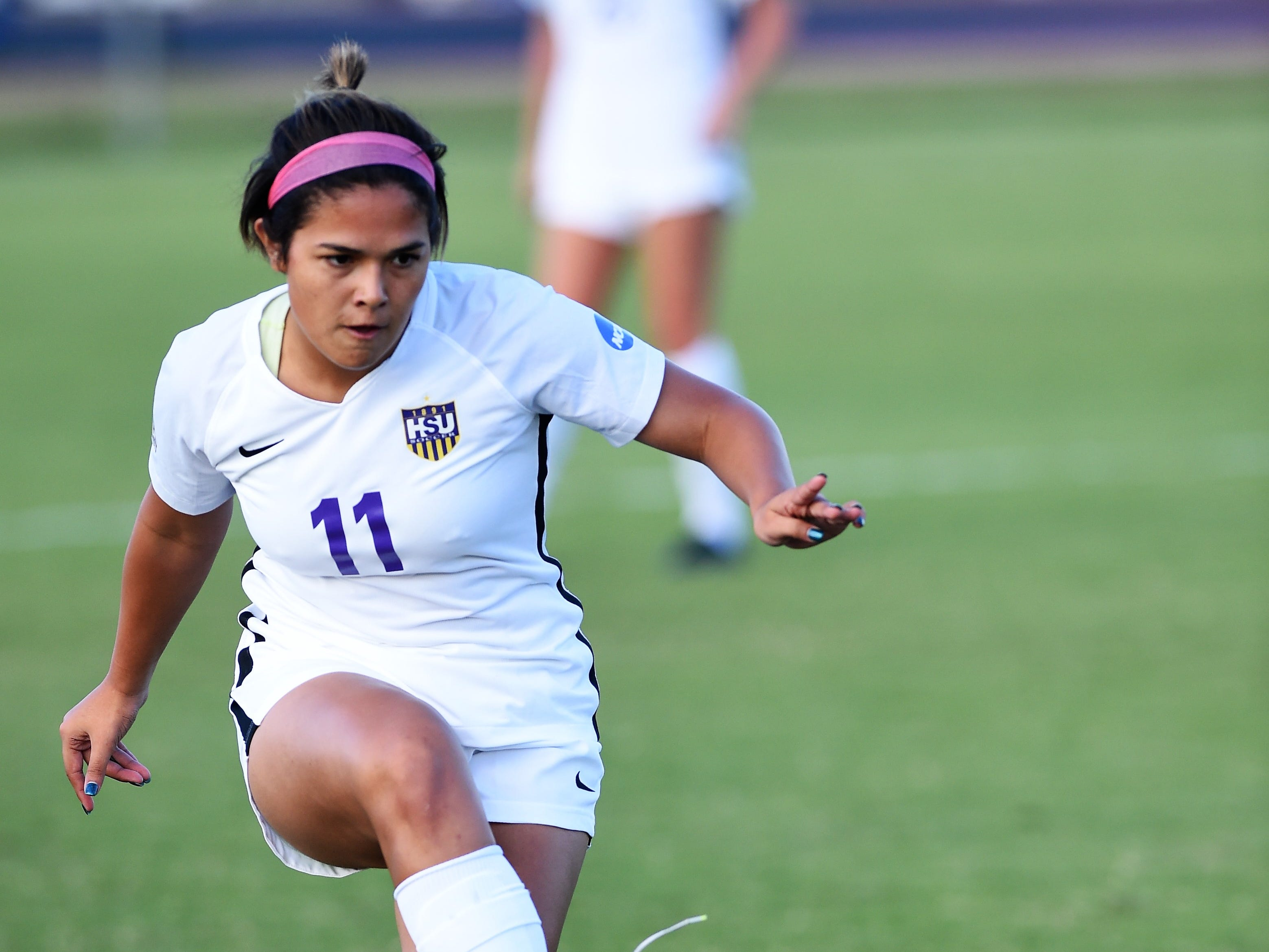 Hardin-Simmons defender Avery Lara (11) makes a pass against Howard Payne at the HSU Soccer Complex on Thursday, Oct. 11, 2018. The Cowgirls won 4-1.