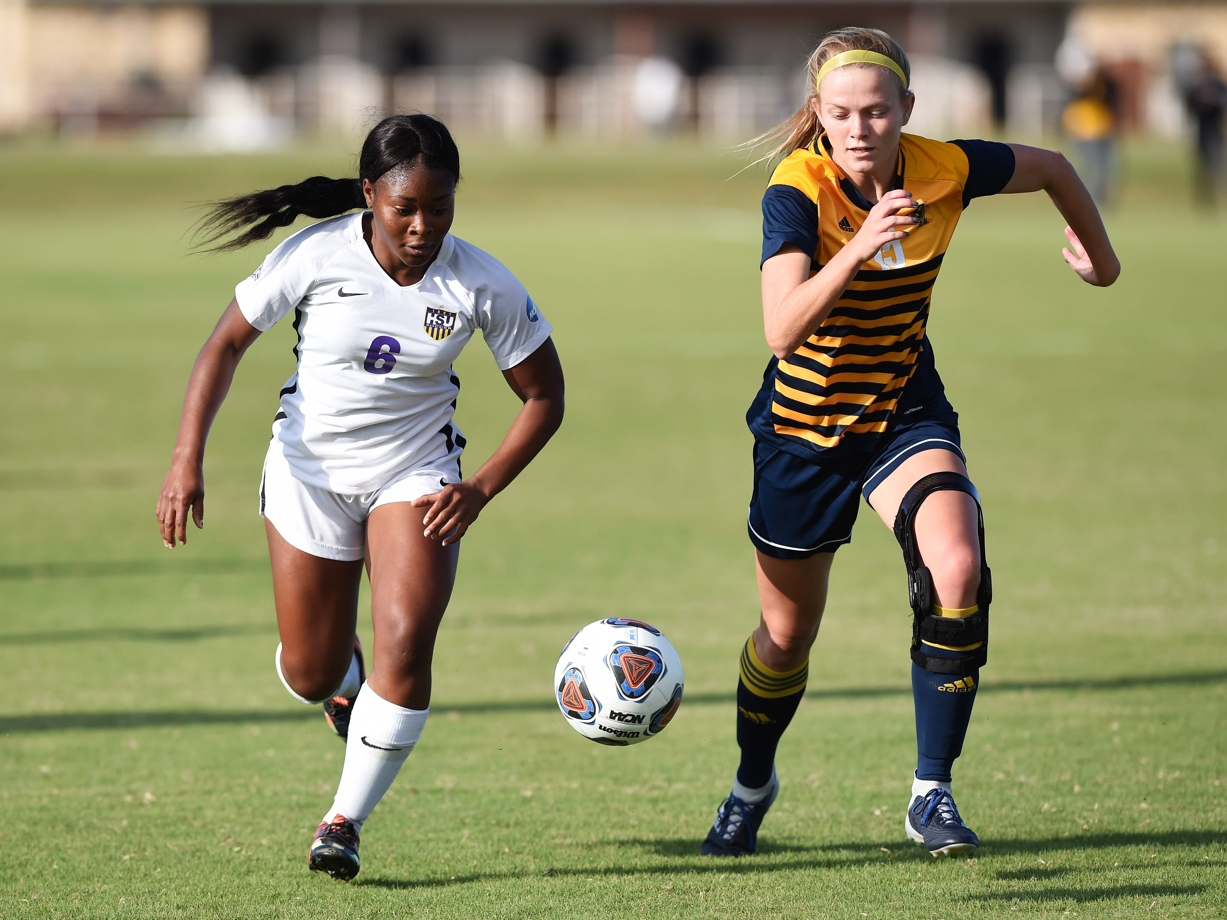 Hardin-Simmons forward Finda Kollie (6) races for the ball against a Howard Payne defender at the HSU Soccer Complex on Thursday, Oct. 11, 2018. The Cowgirls won 4-1.