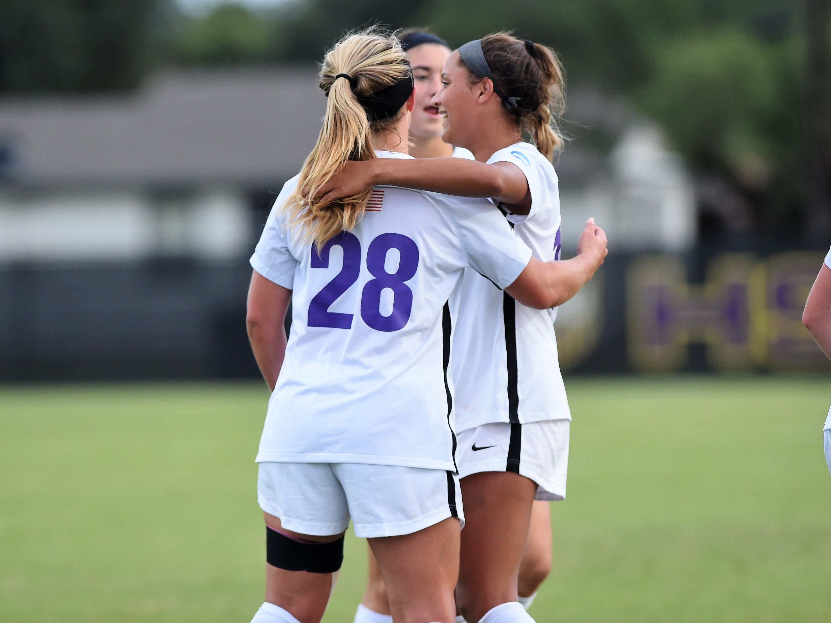 Kenne Kessler (28) is congratulated by Hardin-Simmons teammate Randie Dennison (10) after scoring her third goal against Howard Payne at the HSU Soccer Complex on Thursday, Oct. 11, 2018. The Cowgirls won 4-1.