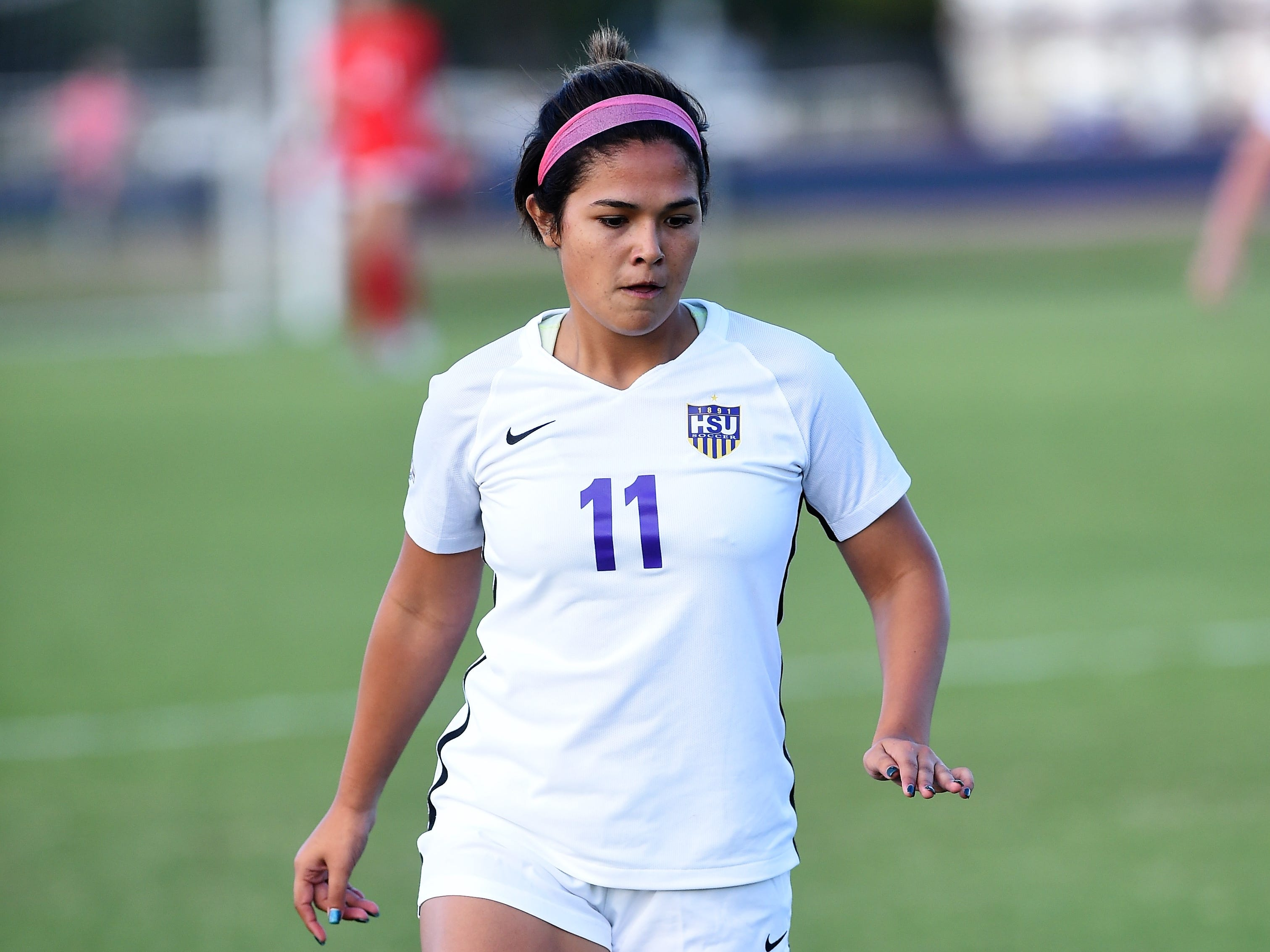 Hardin-Simmons' Avery Lara (11) carries the ball against Howard Payne at the HSU Soccer Complex on Thursday, Oct. 11, 2018. The Cowgirls won 4-1.