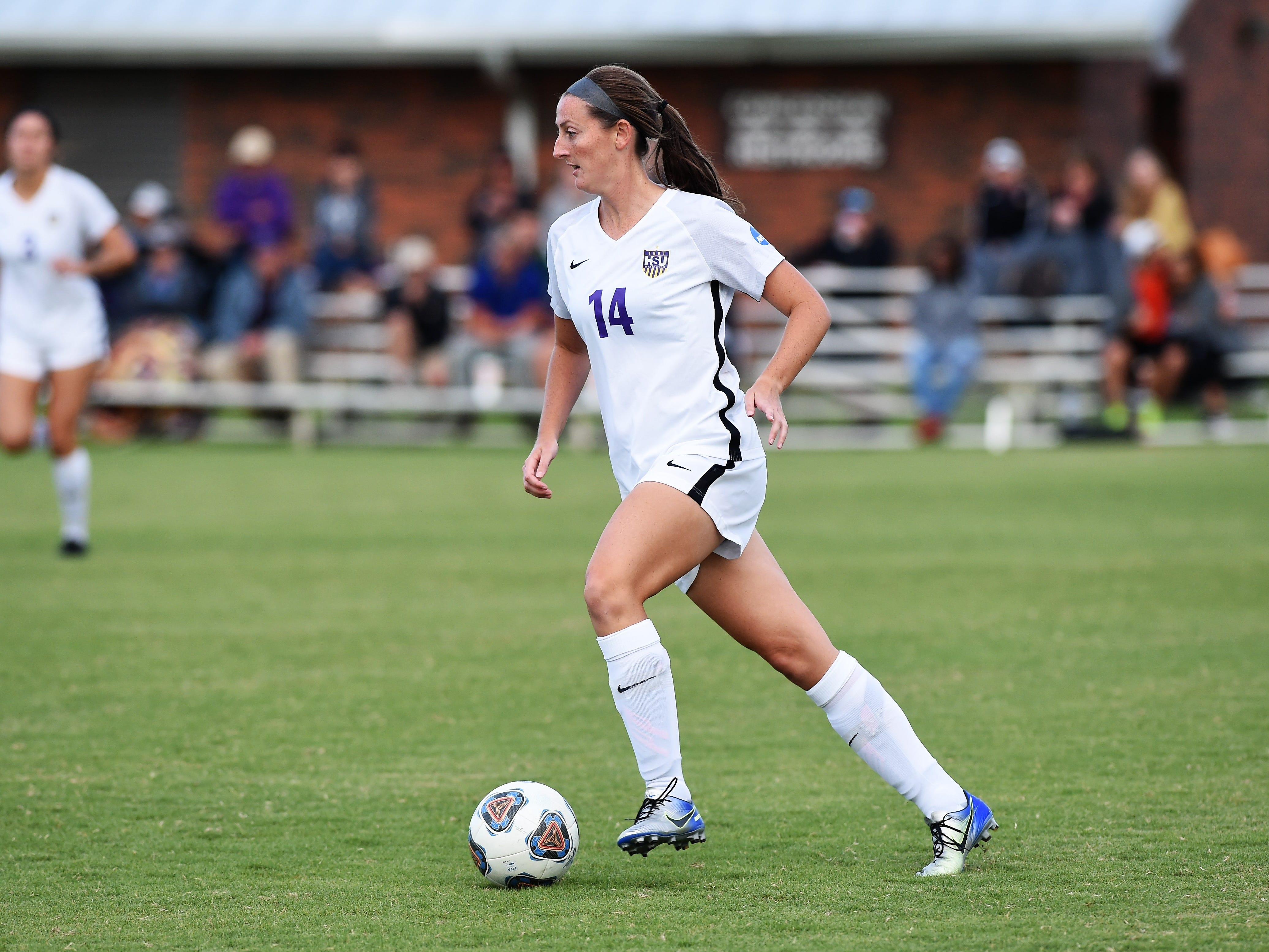 Hardin-Simmons defender Sarah Krisa (14) carries the ball out of the back against Howard Payne at the HSU Soccer Complex on Thursday, Oct. 11, 2018. The Cowgirls won 4-1.