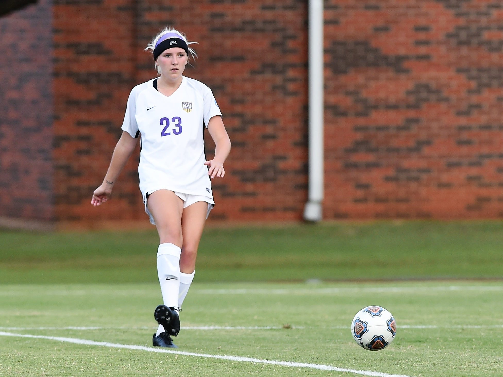 Hardin-Simmons defender Baylee Ford (23) makes a pass against Howard Payne at the HSU Soccer Complex on Thursday, Oct. 11, 2018. The Cowgirls won 4-1.