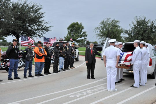 The casket of Navy Reserve Cmdr. Charles B. Goodwin of Haskell is held for several minutes by U.S. Navy sailors before the funeral at the Texas State Veterans Cemetery at Abilene on Friday. Goodwin was declared missing in action in 1965 during the Vietnam War.
