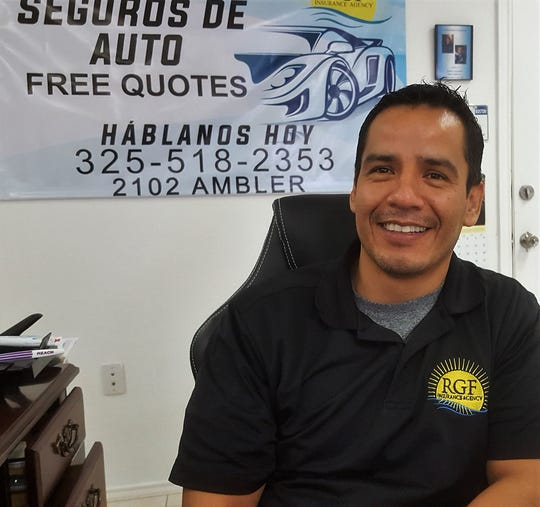 Ricardo Gutierrez sits at his desk in his office.