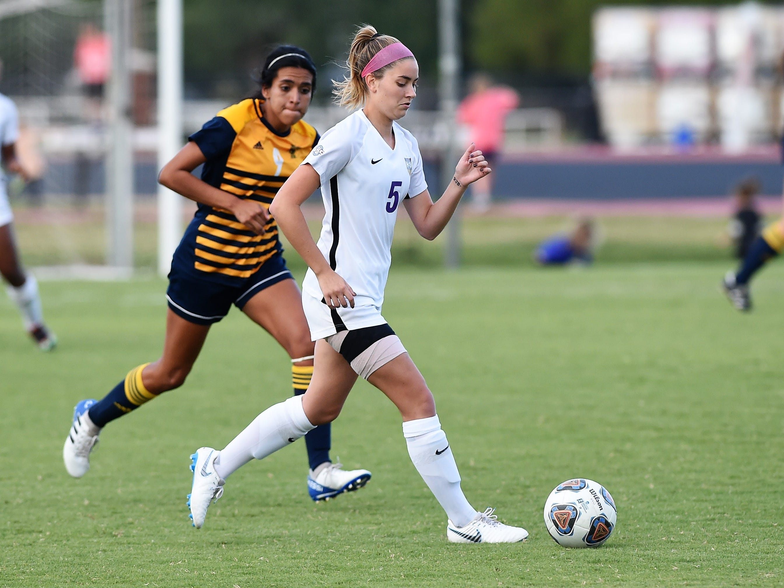 Hardin-Simmons midfielder Evan Pipkin (5) controls the ball against Howard Payne at the HSU Soccer Complex on Thursday, Oct. 11, 2018. The Cowgirls won 4-1.