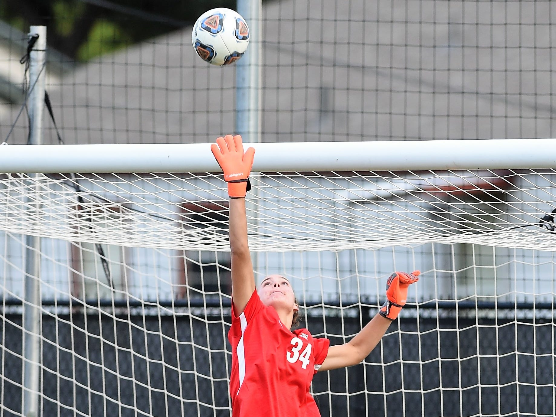 Hardin-Simmons keeper Caitlin Christiansen (34) jumps to knock the ball over the crossbar against Howard Payne at the HSU Soccer Complex on Thursday, Oct. 11, 2018. The Cowgirls won 4-1.