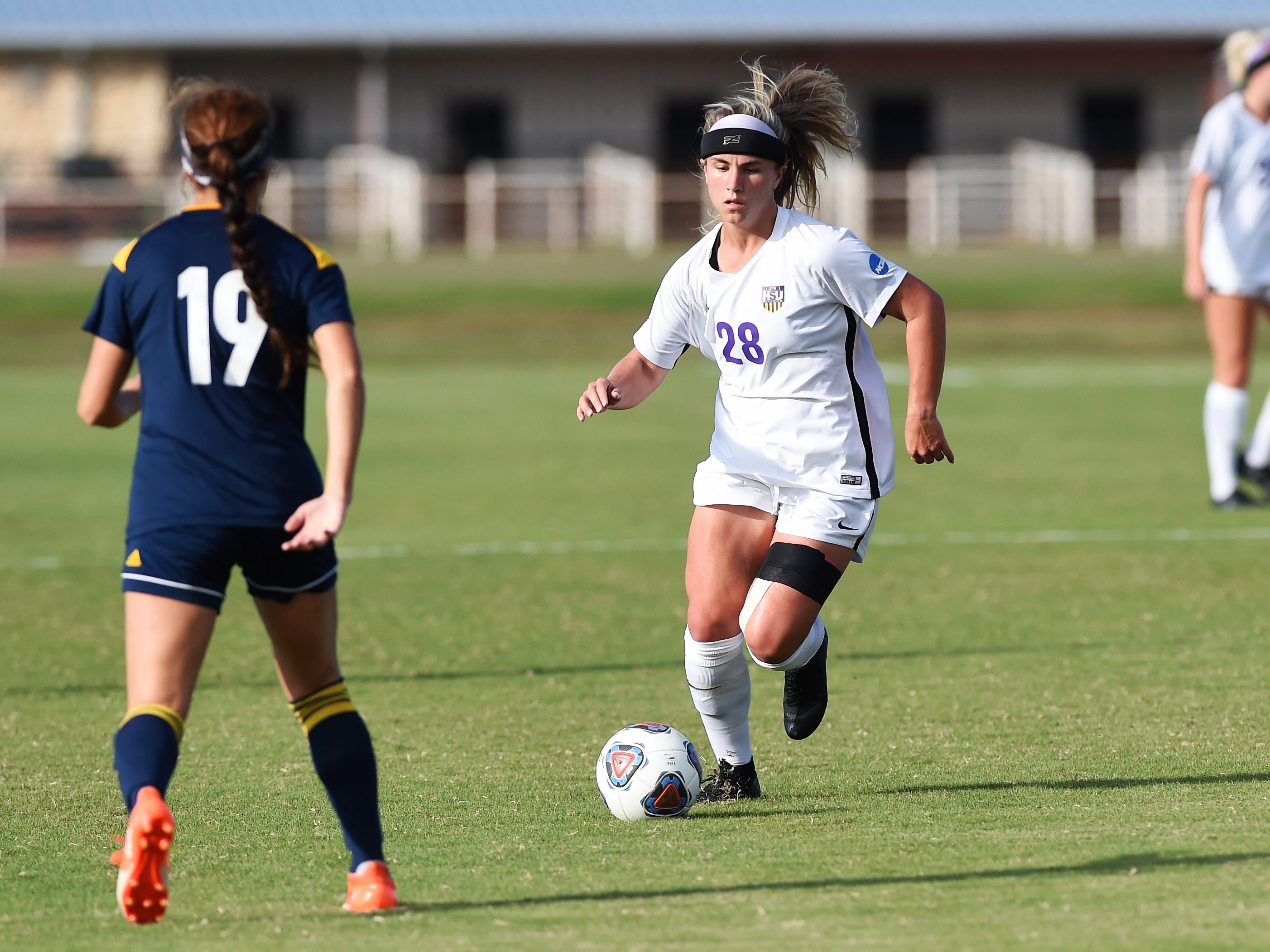 Hardin-Simmons midfielder Kenne Kessler (28) carries the ball downfield against Howard Payne at the HSU Soccer Complex on Thursday, Oct. 11, 2018. The Cowgirls won 4-1.