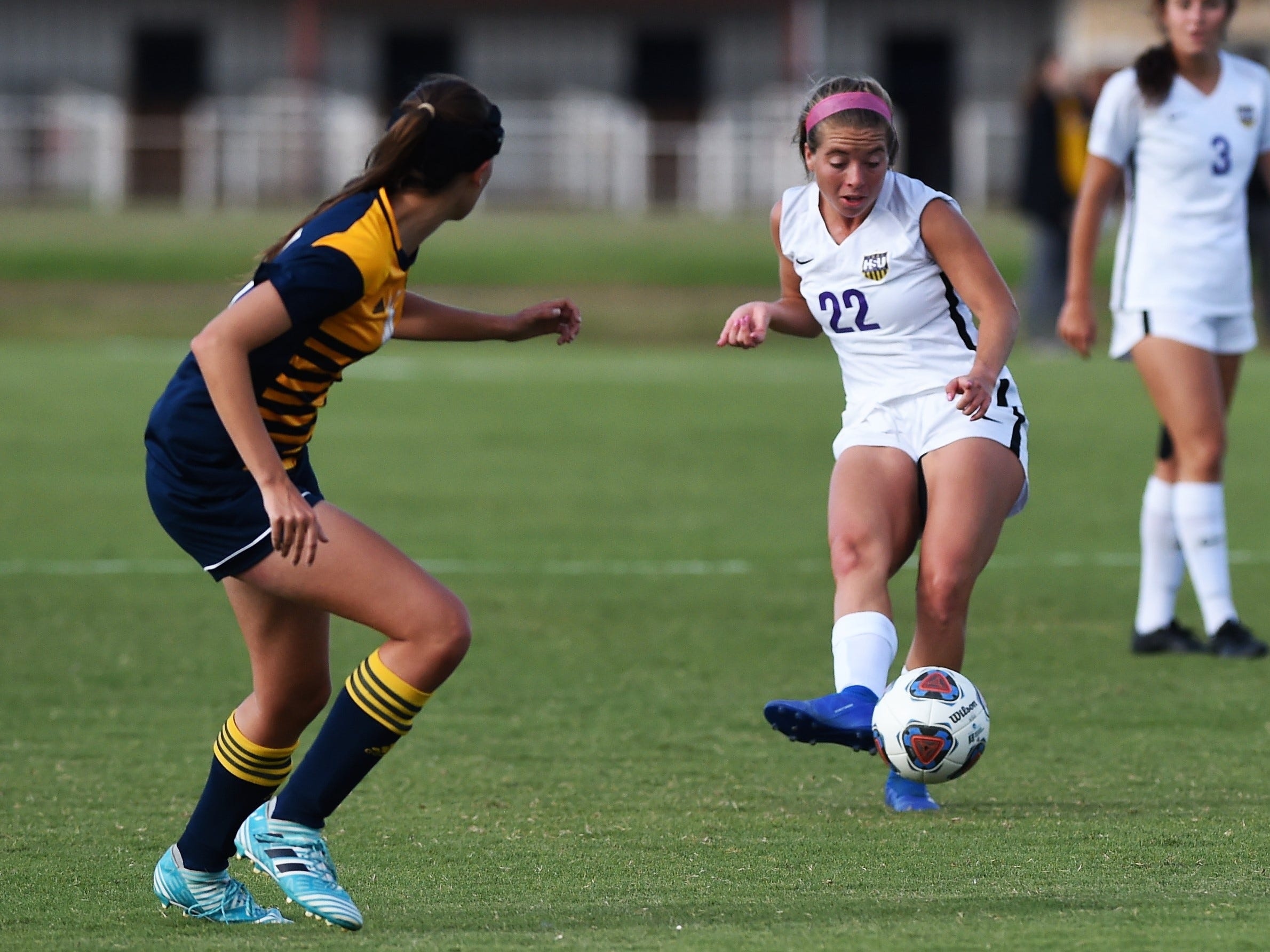 Hardin-Simmons defender Kendell Groom (22) passes the ball against Howard Payne at the HSU Soccer Complex on Thursday, Oct. 11, 2018. The Cowgirls won 4-1.