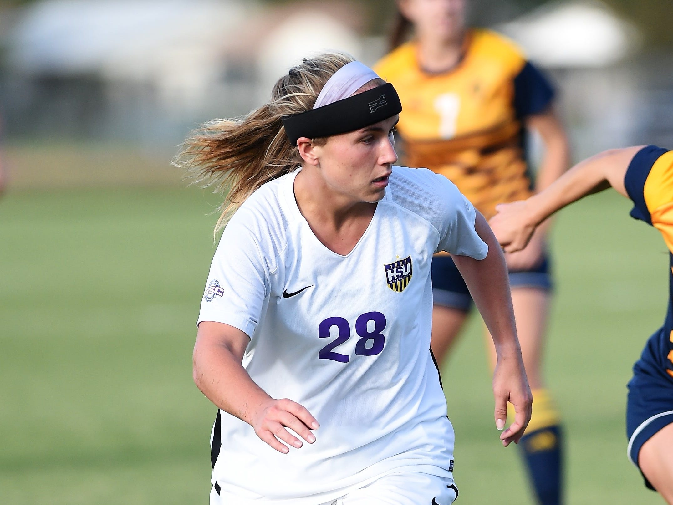 Hardin-Simmons' Kenne Kessler (28) looks to make a pass against Howard Payne at the HSU Soccer Complex on Thursday, Oct. 11, 2018. The Cowgirls won 4-1.