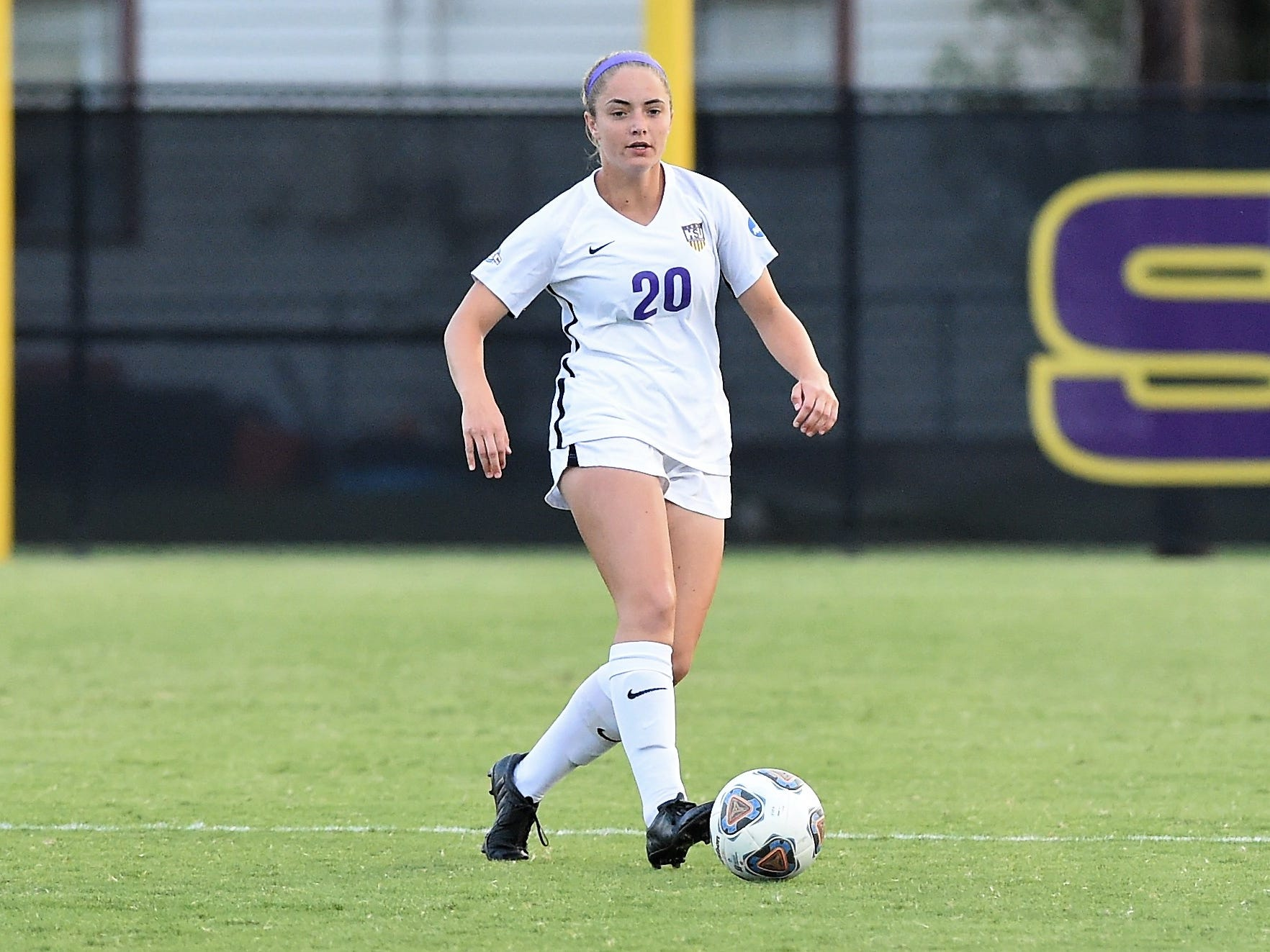 Hardin-Simmons midfielder Morgan McAdams (20) looks to make a pass against Howard Payne at the HSU Soccer Complex on Thursday, Oct. 11, 2018. The Cowgirls won 4-1.