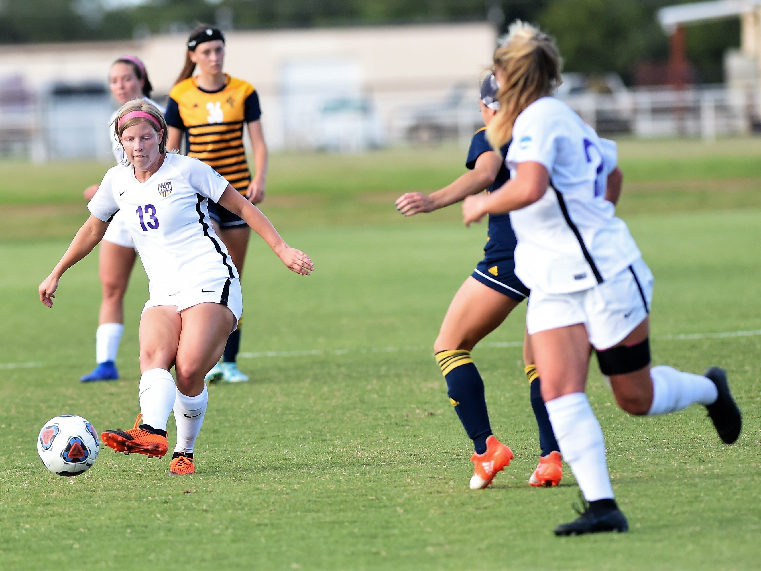 Hardin-Simmons midfielder Josey Meyer (13) passes to Kenne Kessler (28) against Howard Payne at the HSU Soccer Complex on Thursday, Oct. 11, 2018. The Cowgirls won 4-1.