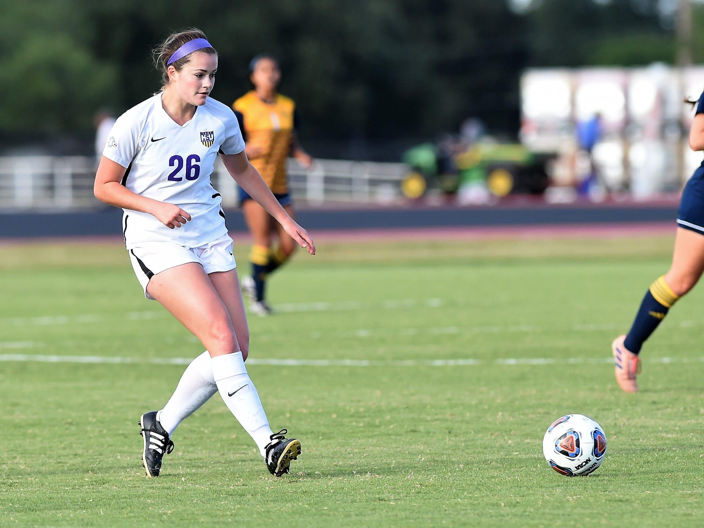 Hardin-Simmons midfielder Rachel bean (26) makes a pass against Howard Payne at the HSU Soccer Complex on Thursday, Oct. 11, 2018. The Cowgirls won 4-1.