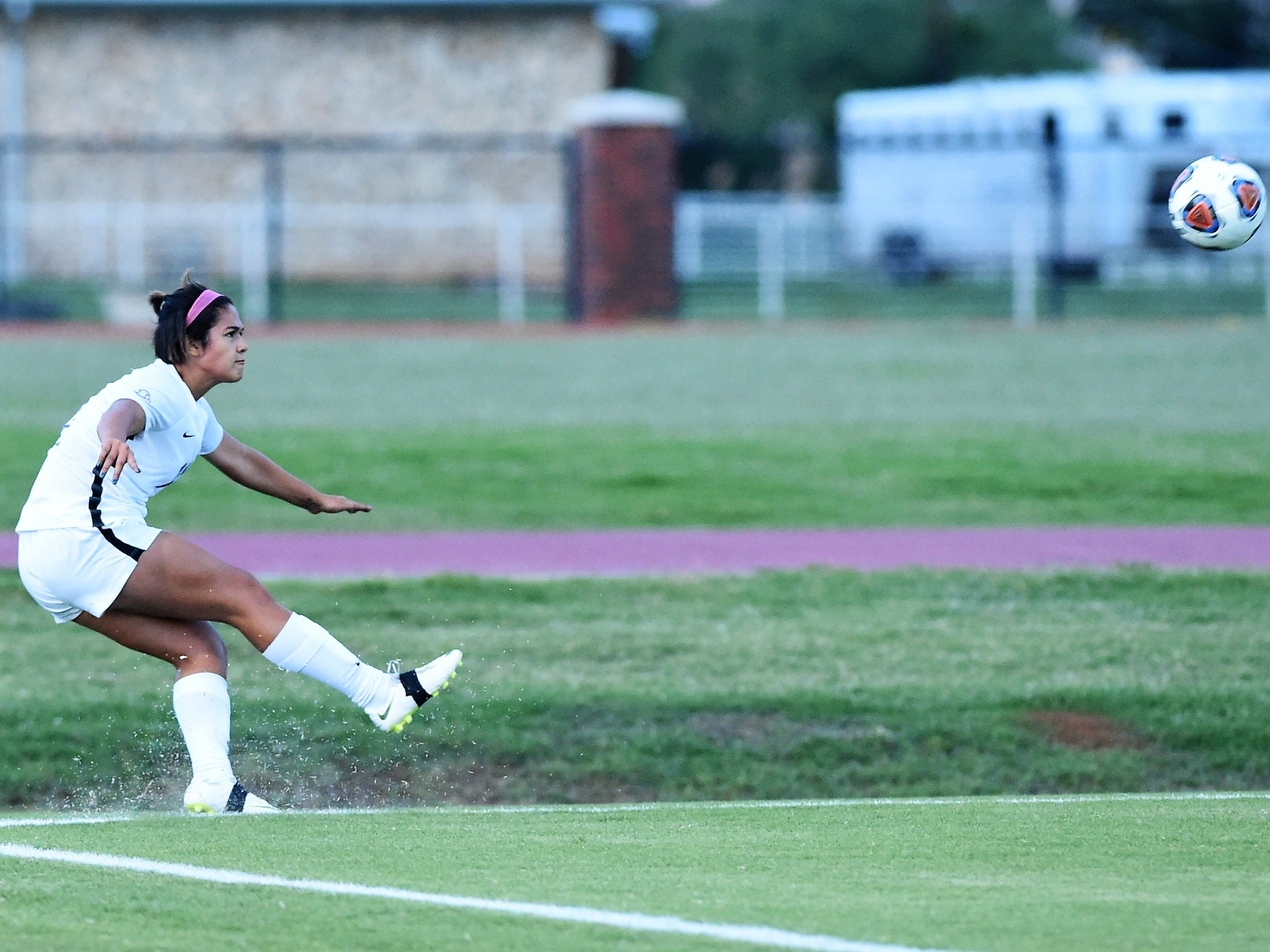 Hardin-Simmons' Avery Lara (11) takes a corner kick against Howard Payne at the HSU Soccer Complex on Thursday, Oct. 11, 2018. The Cowgirls won 4-1.
