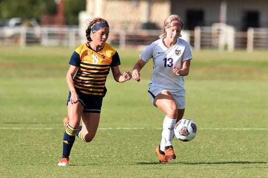Hardin-Simmons midfielder Josey Meyer (13) holds off a Howard Payne defender during Thursday's win. Meyer led the nations in assists last year and is part of a senior class leading the way for this year's Cowgirls.