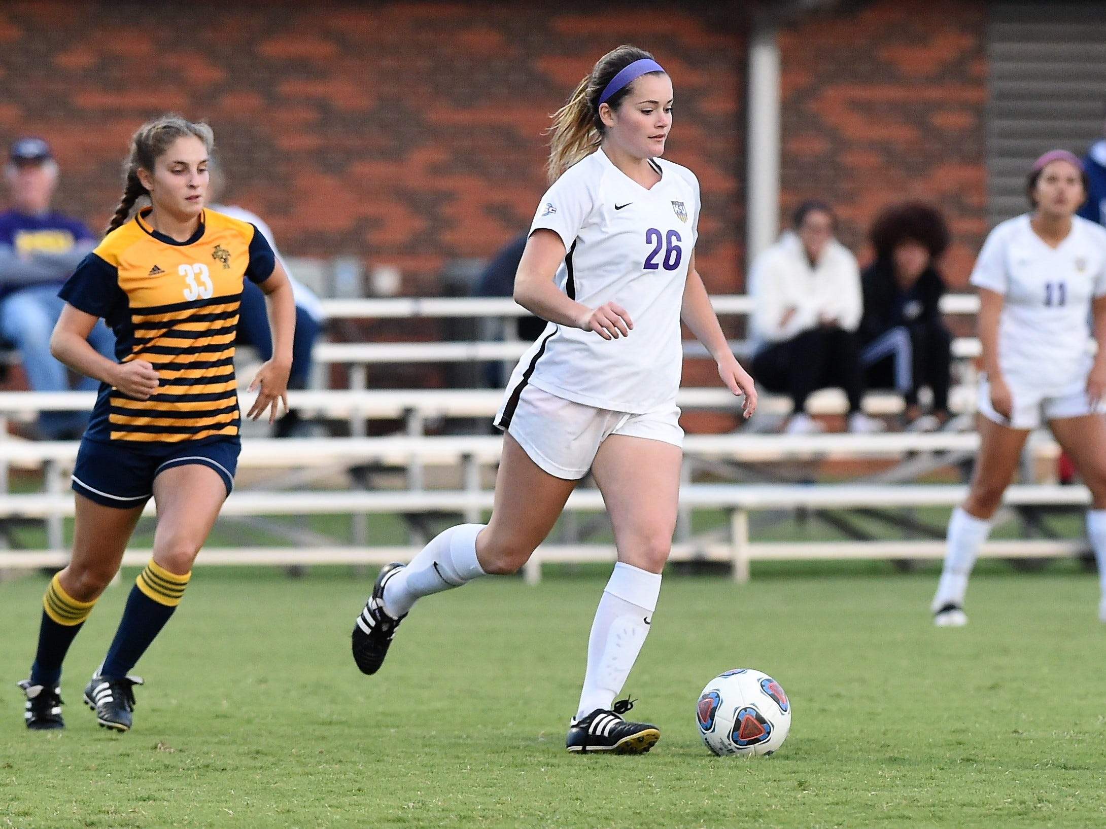 Hardin-Simmons midfielder Rachel Bean (26) controls the ball in space against Howard Payne at the HSU Soccer Complex on Thursday, Oct. 11, 2018. The Cowgirls won 4-1.