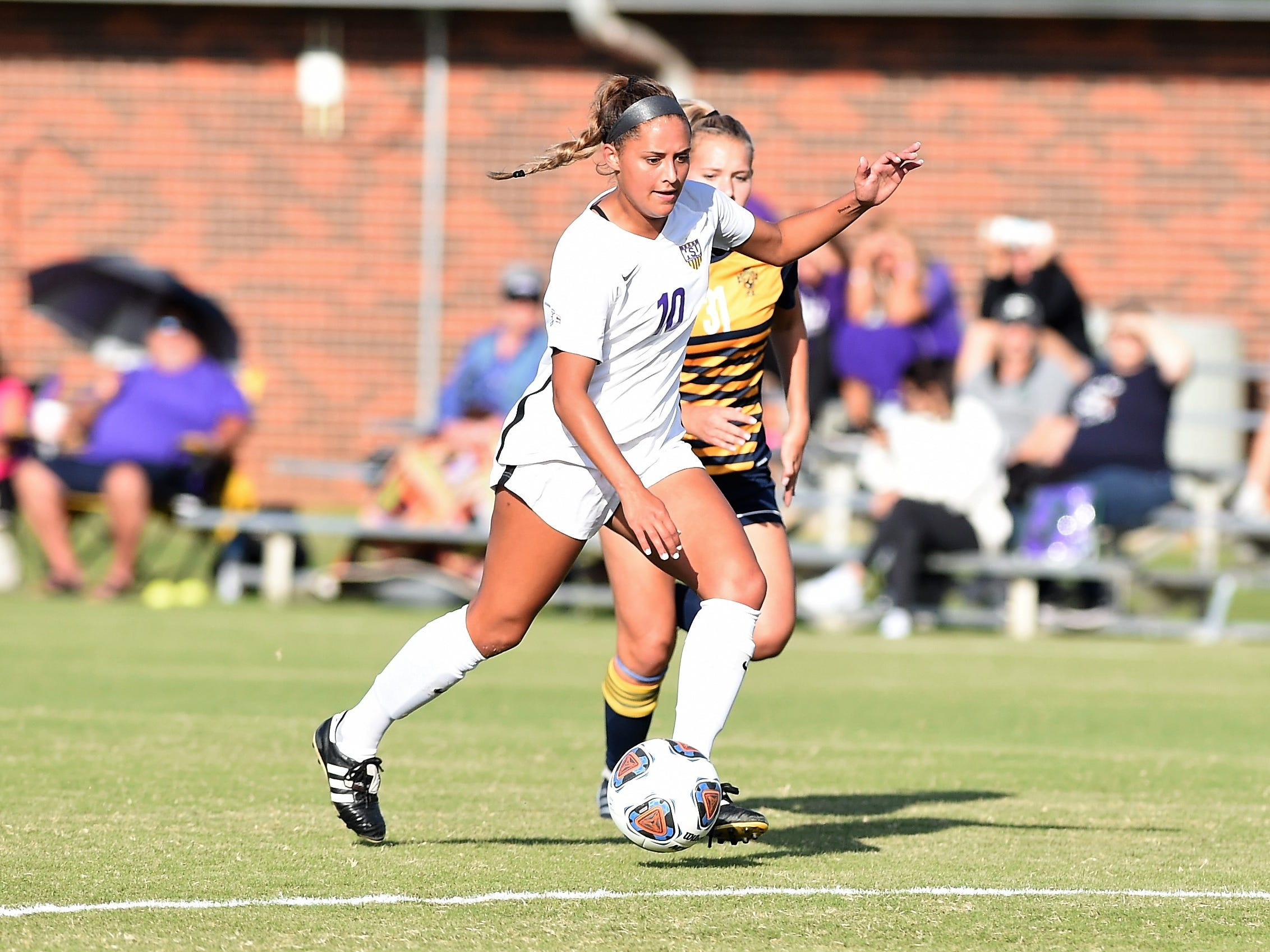 Hardin-Simmons forward Randie Dennison (10) carries the ball into the box against Howard Payne at the HSU Soccer Complex on Thursday, Oct. 11, 2018. The Cowgirls won 4-1.