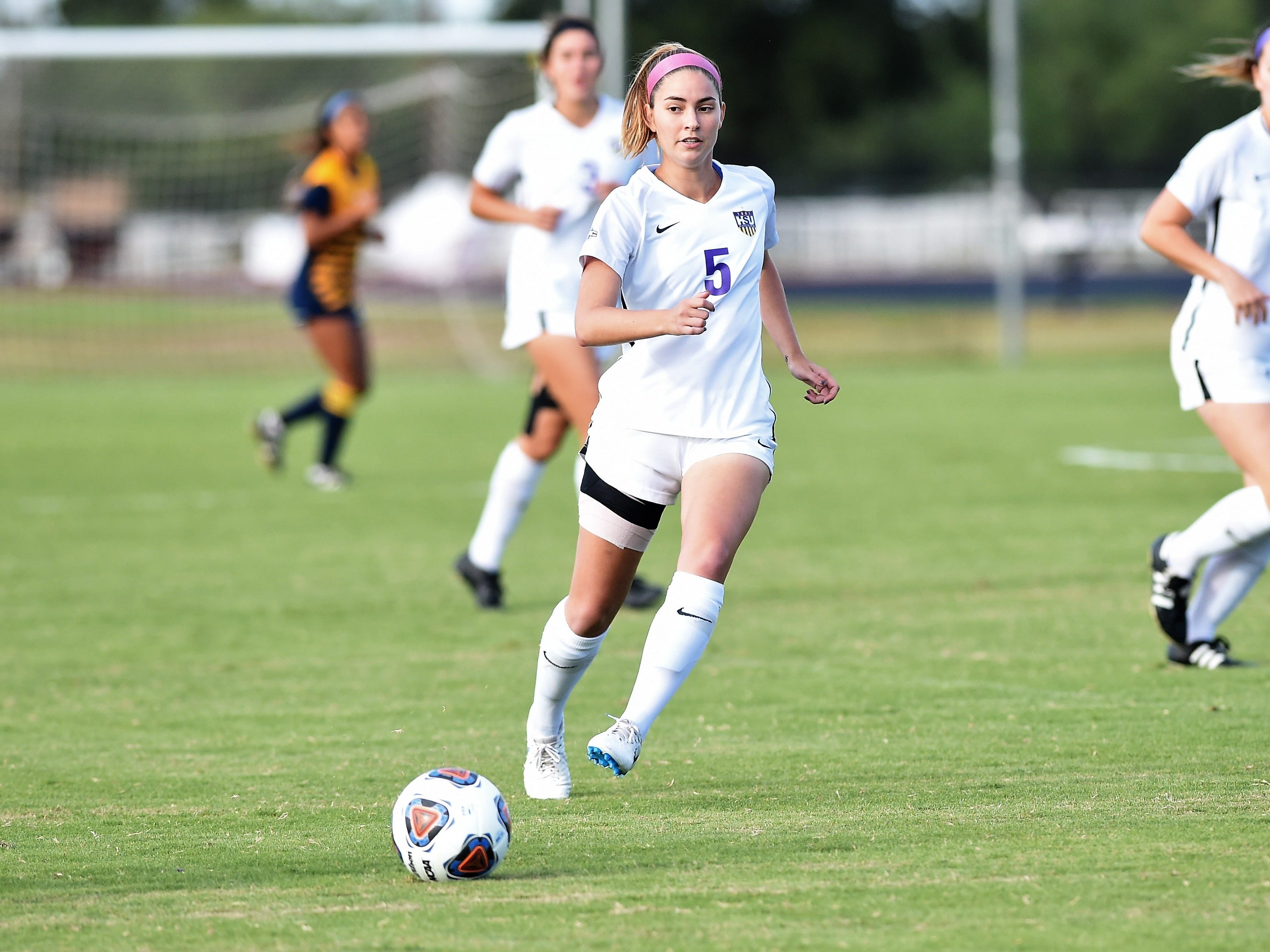 Hardin-Simmons midfielder Evan Pipkin (5) lays a pass off against Howard Payne at the HSU Soccer Complex on Thursday, Oct. 11, 2018. The Cowgirls won 4-1.