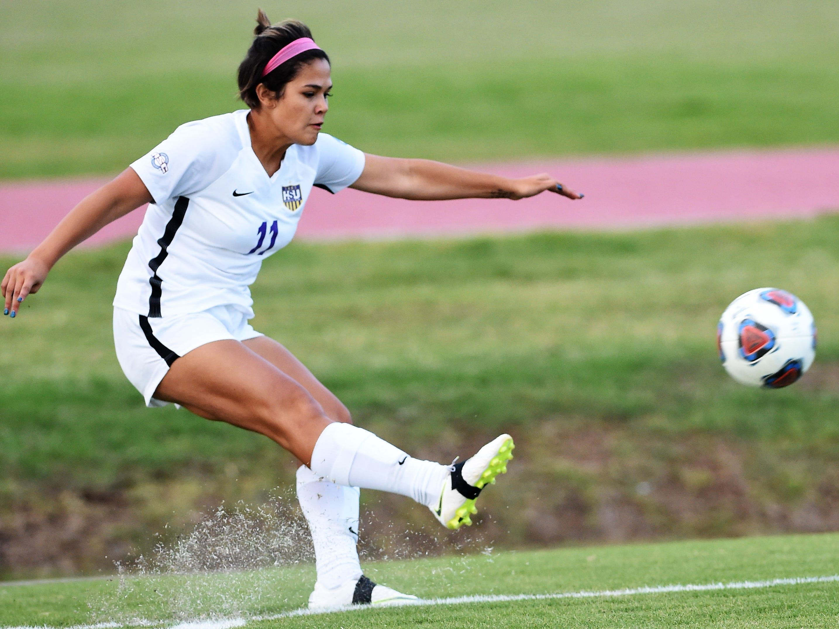 Hardin-Simmons defender Avery Lara (11) takes a corner kick against Howard Payne at the HSU Soccer Complex on Thursday, Oct. 11, 2018. The Cowgirls won 4-1.