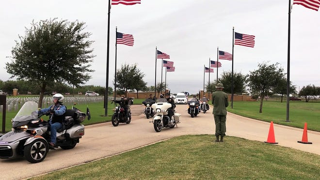 Patriot Guard Riders arrive ahead of the hearse carrying the remains of Navy Reserve Cmdr. Charles B. Goodwin of Haskell at the Texas State Veterans Cemetery at Abilene on Friday. Goodwin was declared missing in action in 1965 during the Vietnam War.
