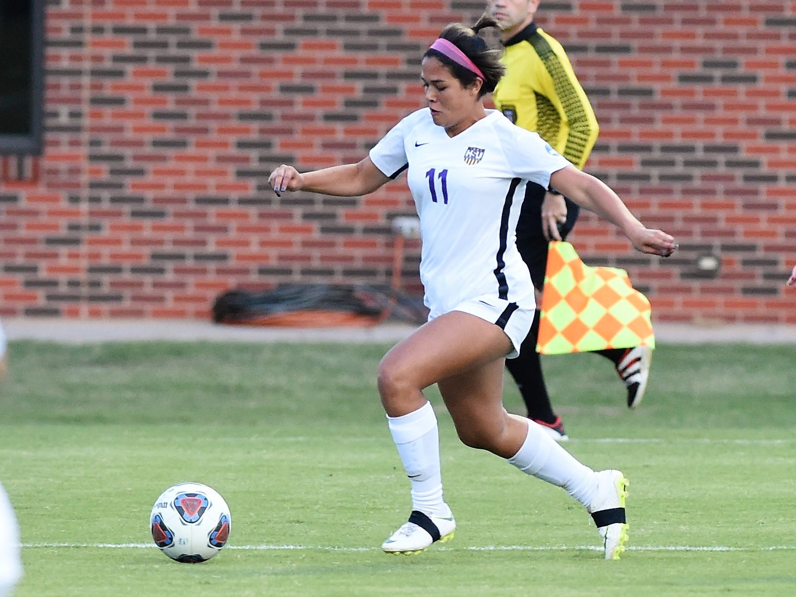 Hardin-Simmons defender Avery Lara (11) carries the ball downfield against Howard Payne at the HSU Soccer Complex on Thursday, Oct. 11, 2018. The Cowgirls won 4-1.