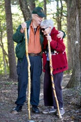 "Walt Weber, 90, stands with his wife, Marcia, 89, on a section of the Mountains-to-Sea Trail that runs along the Blue Ridge Parkway. Weber recently finished the third edition of his book, ""Trail Profiles and Maps: From Clingmans Dome to Mount Mitchell and Beyond,"" about the MST. Along with writing the book, Weber, a member of the Carolina Mountain Club for 25 years, helped build the trail which starts at The Great Smoky Mountains National Park and stretches across North Carolina."