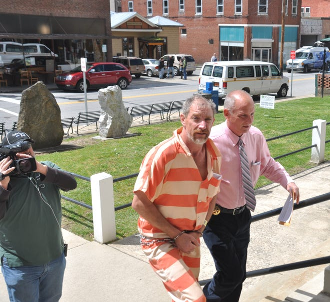 Clinton Dean Shelton is escorted inside the Madison County Courthouse following his arrest in 2016.