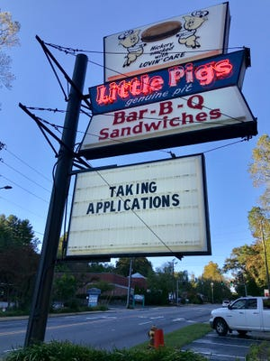 The Little Pigs restaurant sign on McDowell Street actually had a pretty mundane message late last week. But a social media post making the rounds, with a Photo-shopped picture of the sign with a message bashing President Donald Trump, caused the restaurant some headaches.