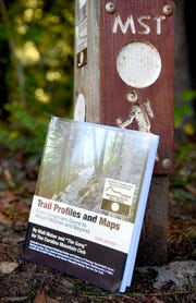 "Walt Weber, 90, recently finished the third edition of his book, ""Trail Profiles and Maps: From Clingmans Dome to Mount Mitchell and Beyond,"" about the Mountains-to-Sea trail. Along with writing the book, Weber, a member of the Carolina Mountain Club for 25 years, helped build the trail which starts at The Great Smoky Mountains National Park and stretches across North Carolina."