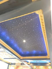 The starry night sky Carrie Jones painted, illuminated by blue lights.