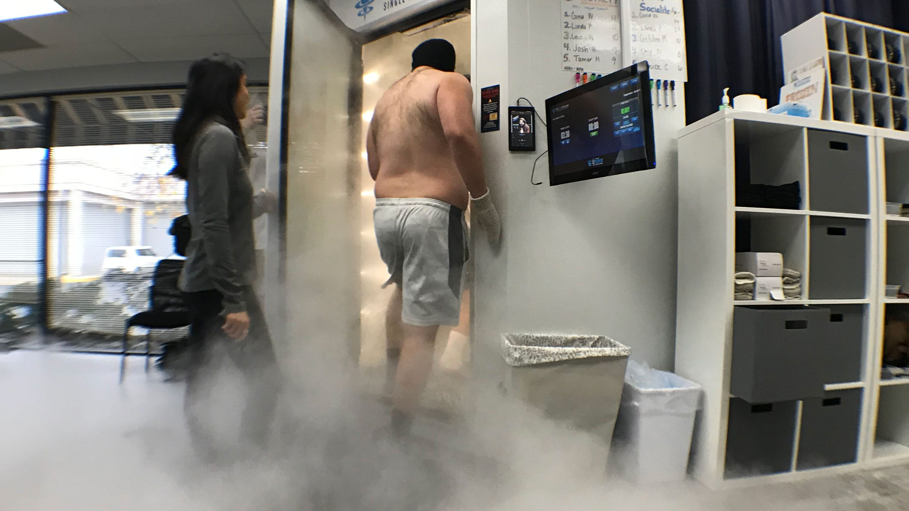 Western Michigan University offensive lineman Jon Keenoy enters the whole body cryotherapy chamber at US Cryotherapy in Portage.